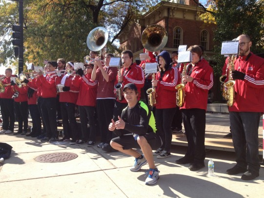 Stephen Ragalie stops for a photo with the Pep Band at Mile 17.