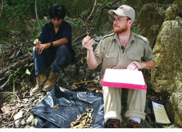 Caleb Kestle, a Ph.D. candidate in anthropology, examines ancient animal bones.