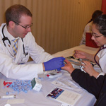 Stephen Schwartz and Jacqueline Restrepo conduct health screenings Oct. 21 at St. Pius V Parish in Pilsen.
