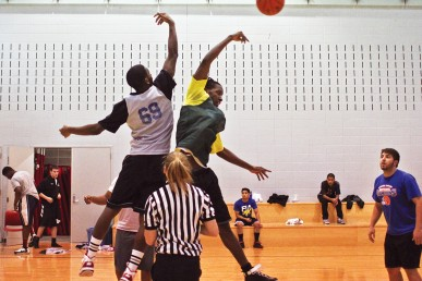 students playing intramural basketball
