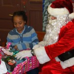 Officer Santa Braulio DeAnda hands out gifts