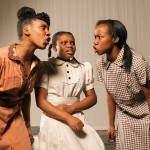 "iera Alexander, Chiagoziem Nwakanma, and Jazzlyn Luckett in a scene from ""The Bluest Eye"""