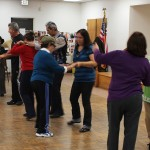 Seniors participating in a salsa dancing class