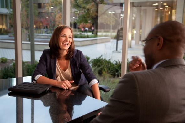 Woman smiles in meeting with man