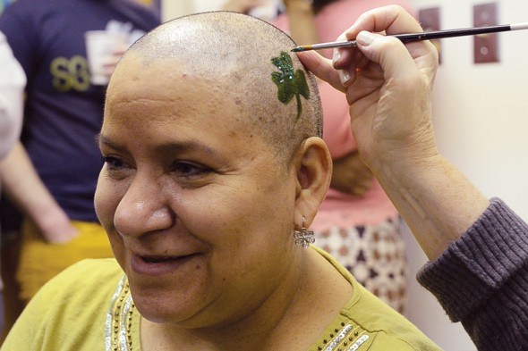 Antonia Pyzik gets a shamrock painted on her freshly-shaved head