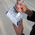Person holding a palm pilot