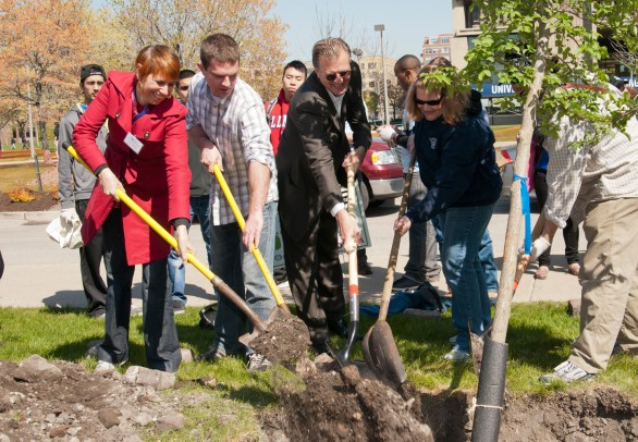 Students, staff and Arbor Day Foundation representatives plant a tree on campus for Arbor Day 2012.