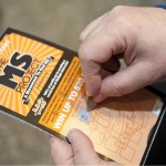 Using a coin to scratch off a lottery ticket