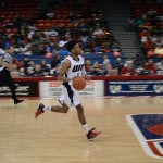 Gary Talton drives down the court