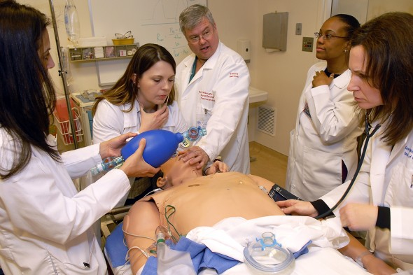 Nursing students learn intubation by working on a mannequin.