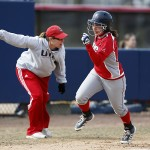 Jenna Marsalli runs as softball coach Michelle Venturella gestures her on
