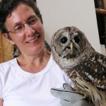 Maria Carrasco holding a barred owl