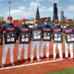 Graduating baseball players hold their commemorative plaques
