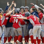 Softball team celebrating