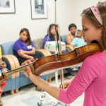 Clarissa Bevilacqua plays violin at the Children's Hospital
