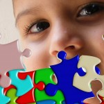 child's face behind puzzle pieces