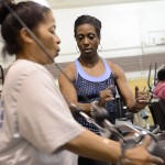 Moving Forward participant works out with a trainer