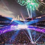 Crowd in Soldier Field with fireworks behind