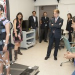 Congressman Peter Roskum observes a physical therapy research lab
