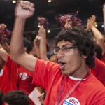 Male student in the crowd cheering
