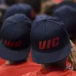 Young man wearing a UIC baseball hat backwards