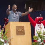 Men's basketball head coach Howard Moore and Sparky D. Dragon at convocation.