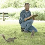 Steve Sullivan observes two squirrels in Lincoln Park