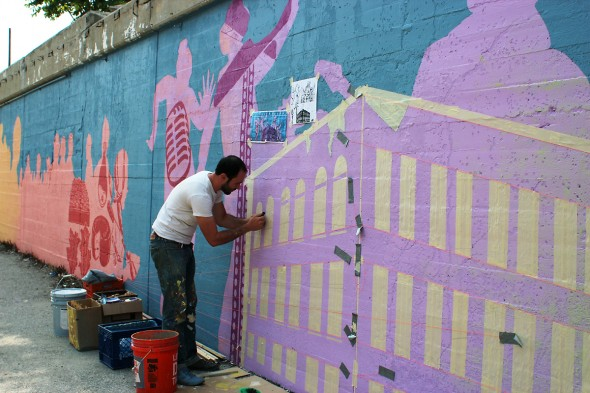 Nick Goettling working on the Morgan Street Mural