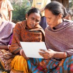 Indian women looking at illustration during a family planning session