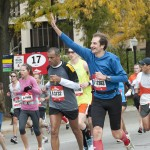 2012 Chicago Marathon runners pass the UIC campus