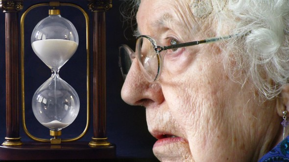 Elderly woman and an hourglass