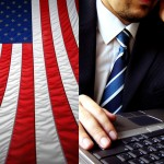American flag and photo of man in tie at keyboard