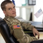 American soldier sitting at a laptop
