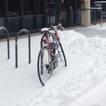 bicycle locked up in the snow