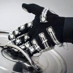 Hand wearing haptics glove holding the lid of a pot