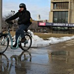 man riding bicycle on campus