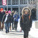 students walking on campus with snow
