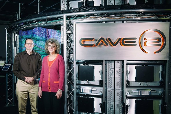 Andrew Johnson and Maxine Brown in front of CAVE2, advanced 3-D environment