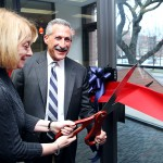Linda Deanna and Lon Kaufman cut the ribbon to open the center