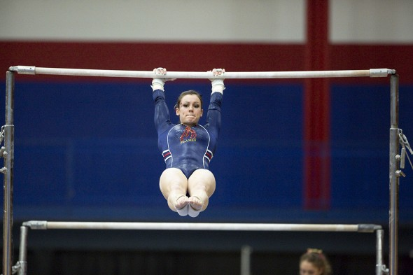 Catherine Dion on the uneven bars