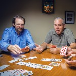 Pat Bauer, Don Arnold, and Craig Skweres playing cards