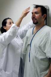 Doctor measures the height of a study participant