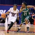 Terri Bender races a Cleveland State player down the court