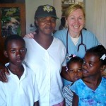 Sue Walsh with Haitian family