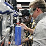 Lukasz Adamczyk and Nikhil Chintalpudi create acetylene gas in the new physical chemistry lab