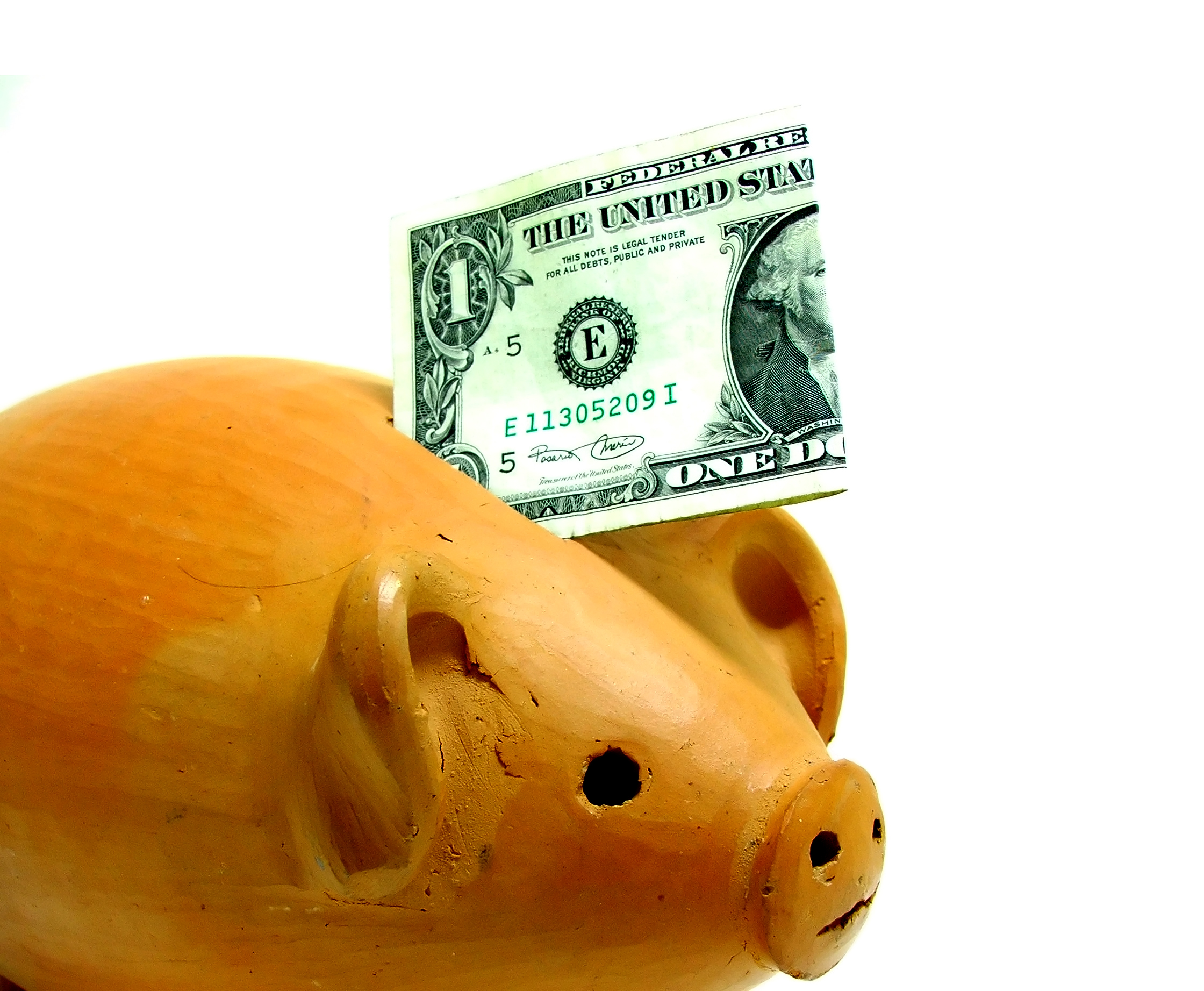 piggy bank with a dollar sticking out of it