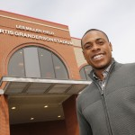 Curtis Granderson outside entrance to new stadium