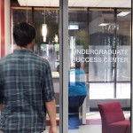 Student walking into the Undergraduate Success Center