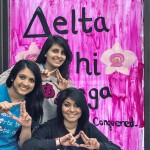 Women from the Delta Chi Omega sorority in front of their painted window