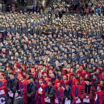 Crowd of graduates standing during ceremony